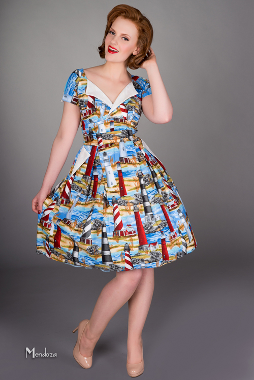 Classic vintage occasional dress with pockets and pleated skirt